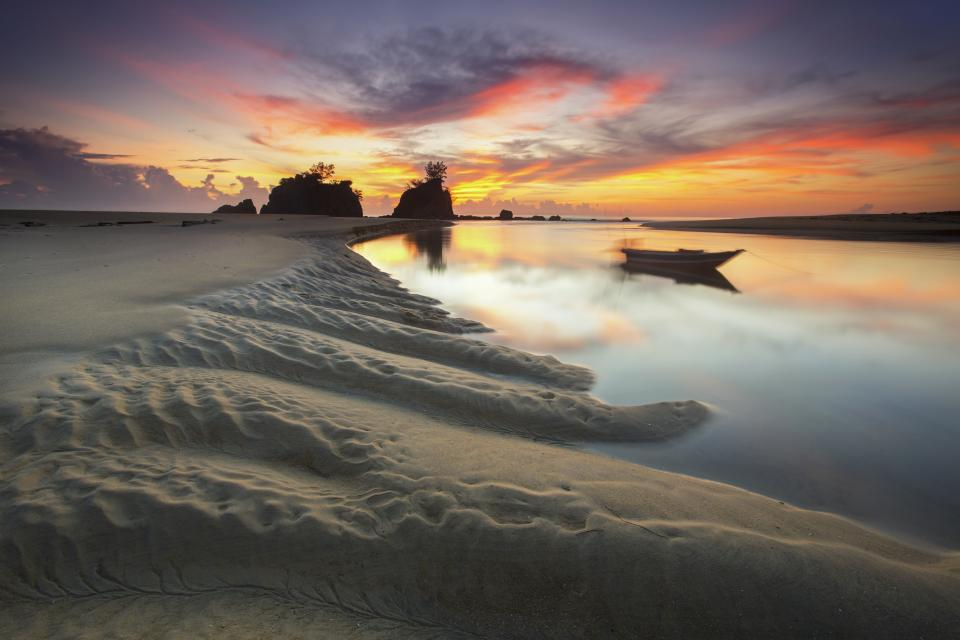 nature landscape coast islands shore sand boat water sea reflection sky clouds horizon