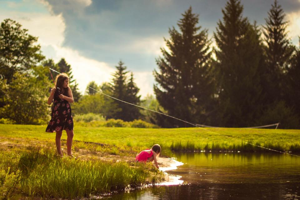 lake water people woman mother daughter kid baby playing green grass nature trees plant cloud sky outdoor