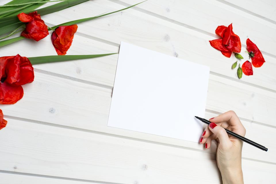 lifestyle work paper pencil red flowers desk white wooden table write