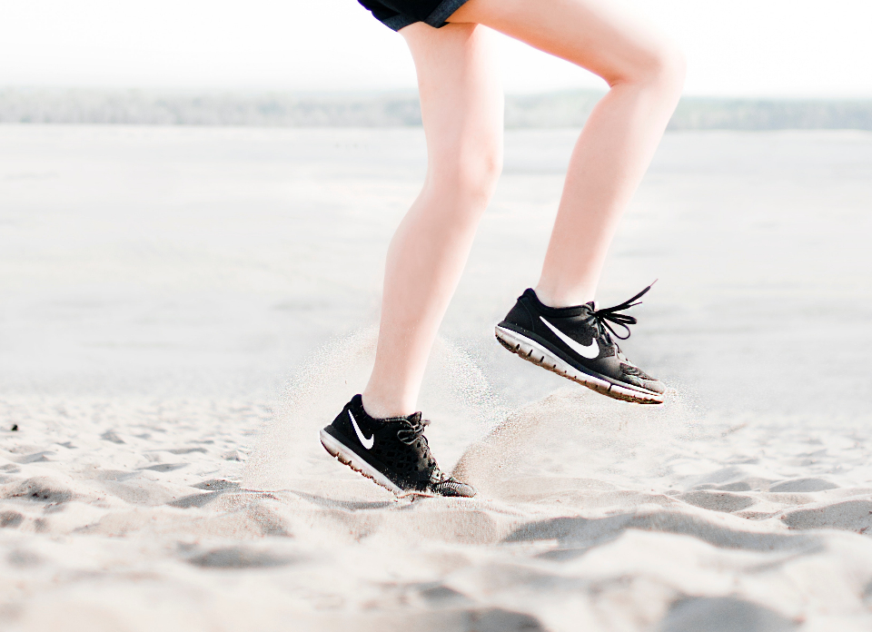woman sneakers jumping summer beach sand female girl sport running fit