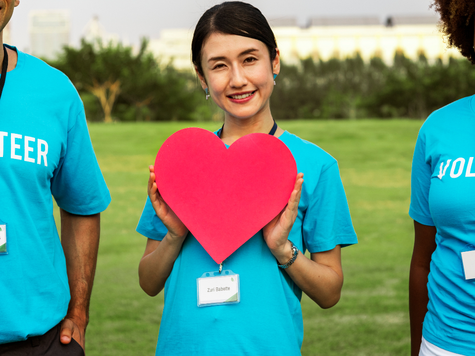 adult charity group care cheeful community community service diverse donation friendship happiness healthcare heart humanity icon kindness love woman female people outdoors park smiling