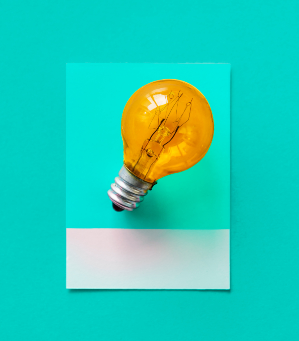 bulb card colorful concept conceptual creative creativity design electric electrical electricity energy glass glowing green heat idea image innovation inspiration invention isolated light light bulb object orange paper