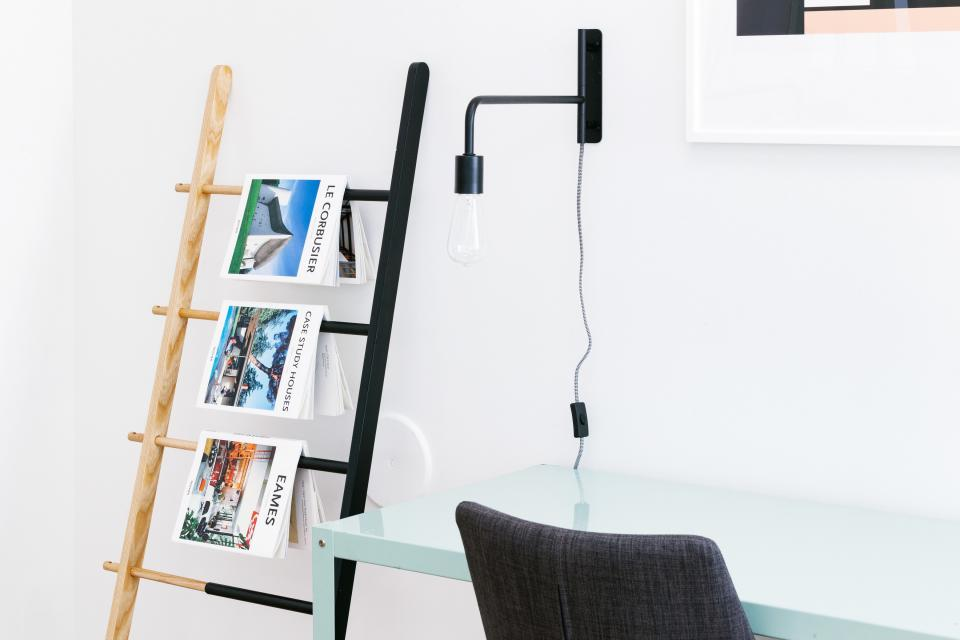 magazines newspaper rack interior business office white table chair light bulb lamp furniture