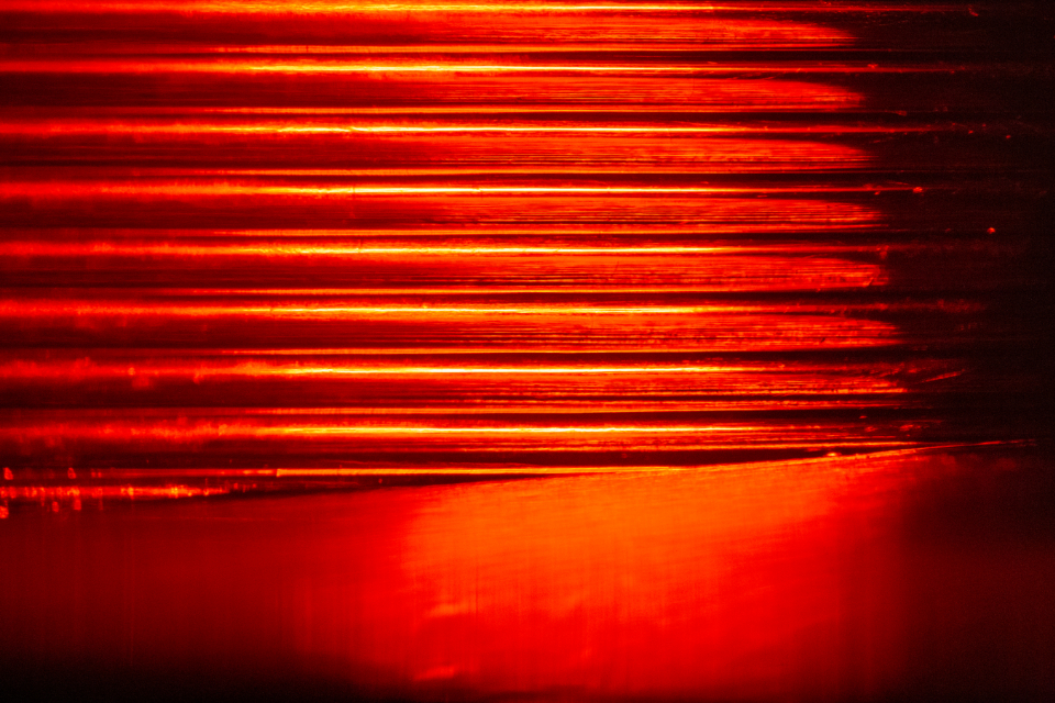 red texture shiny pattern reflection background abstract tail light bold design glow car automotive