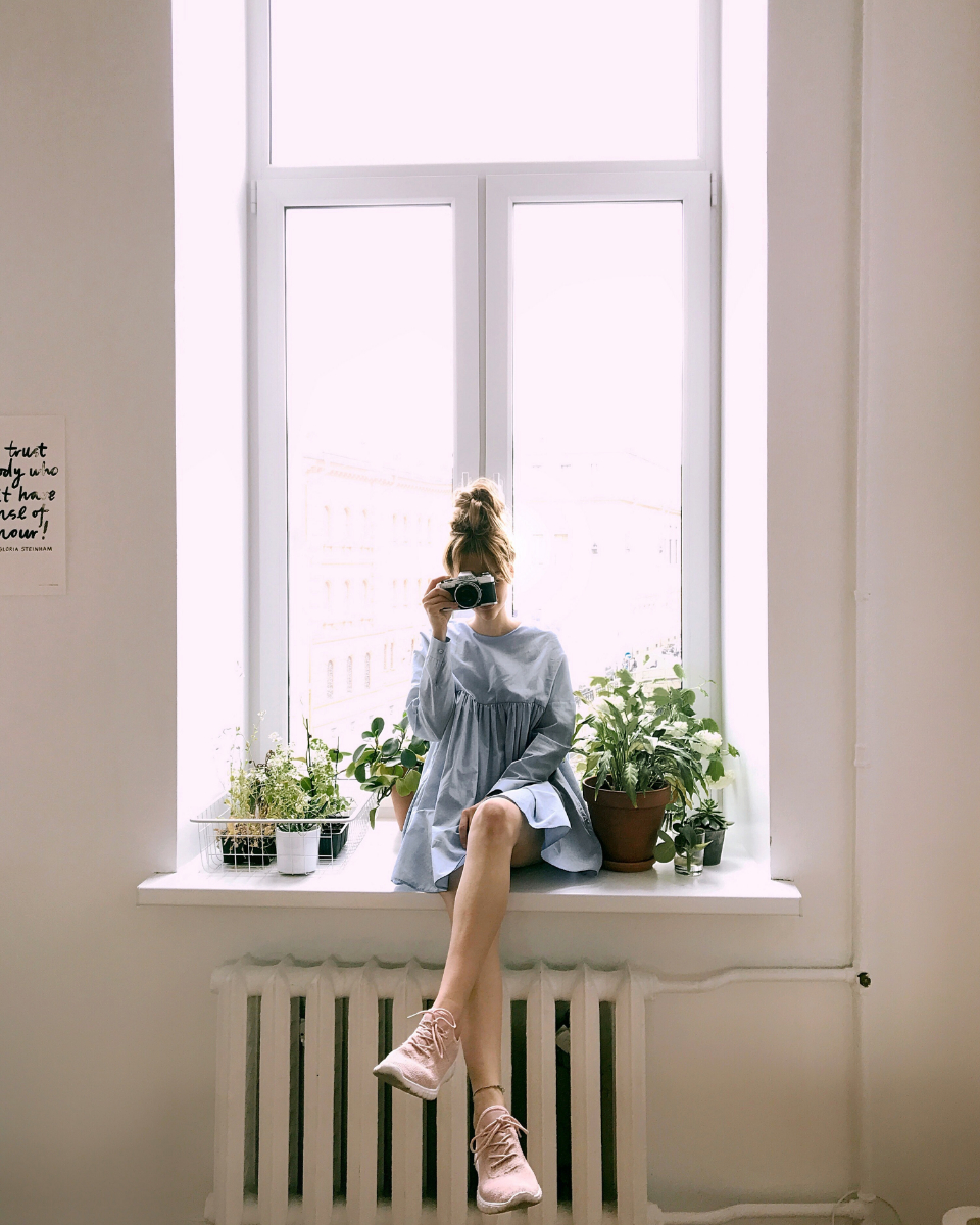 woman crossed legs window sill house model fashion girl female people photographer camera smile happy