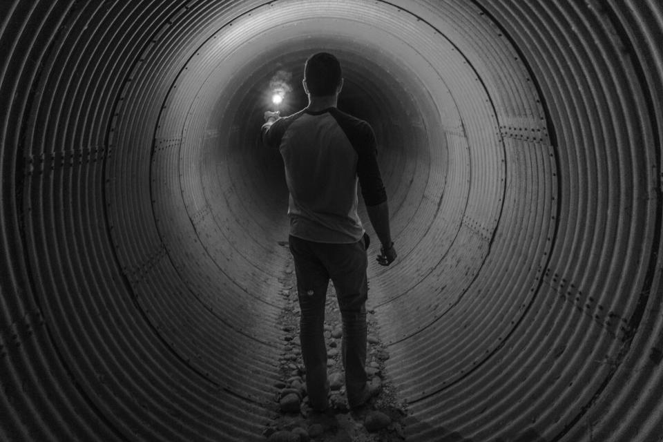 guy flare tunnel light people black and white