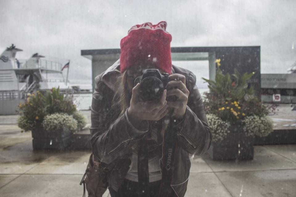 canon camera lens black photography people red beanie glass outside plant nature cloud sky