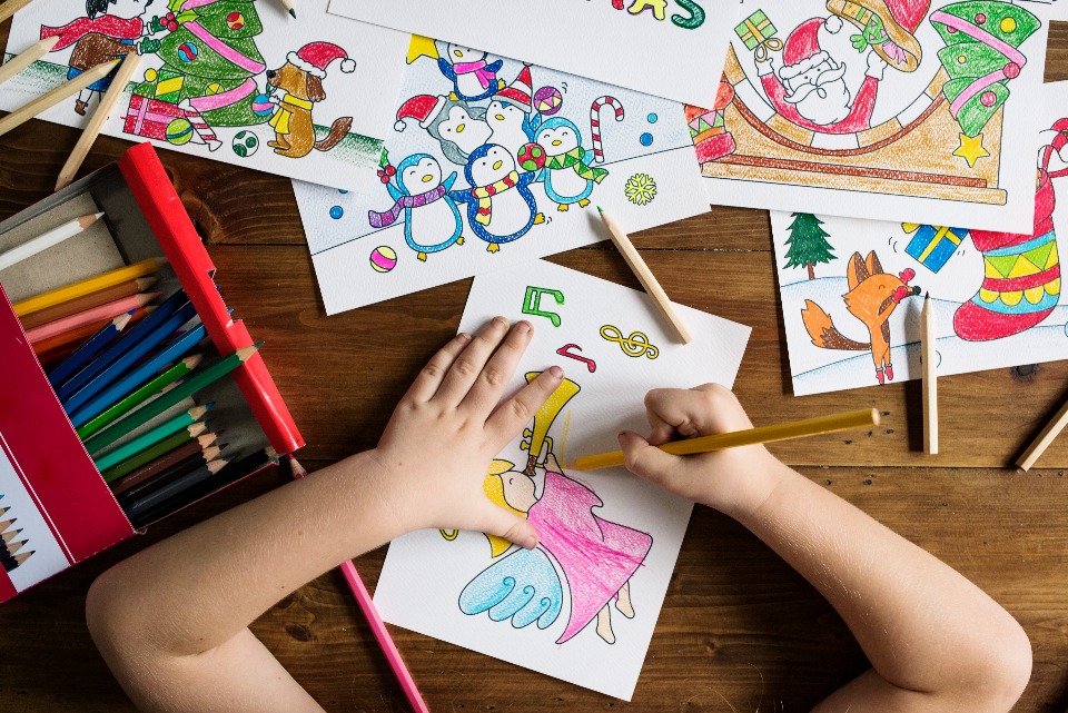 kids kid child children elementary little kids childhood christmas holiday yuletide workshop learn learning educate education drawing color coloring fun art school art class wooden table drawings student activity activities