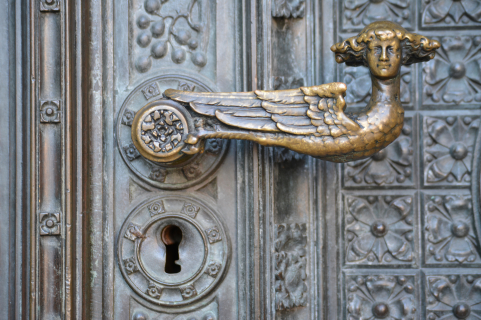 lock door ornate close up keyhole doorknob design old antique metal brass decoration architecture sculpture wings