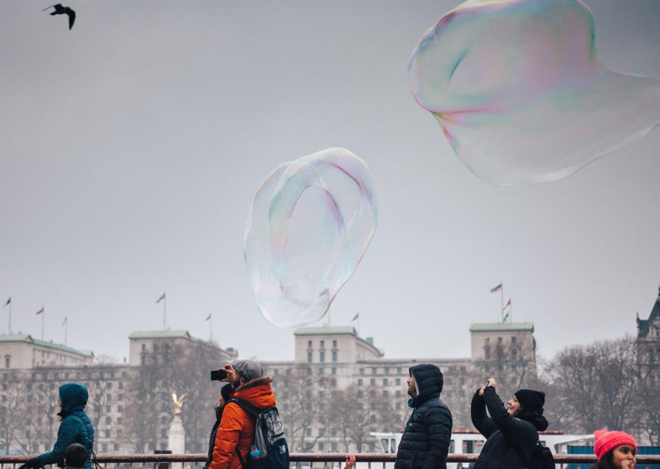 people bubbles camera picture photography cold weather coat establishment building urban city