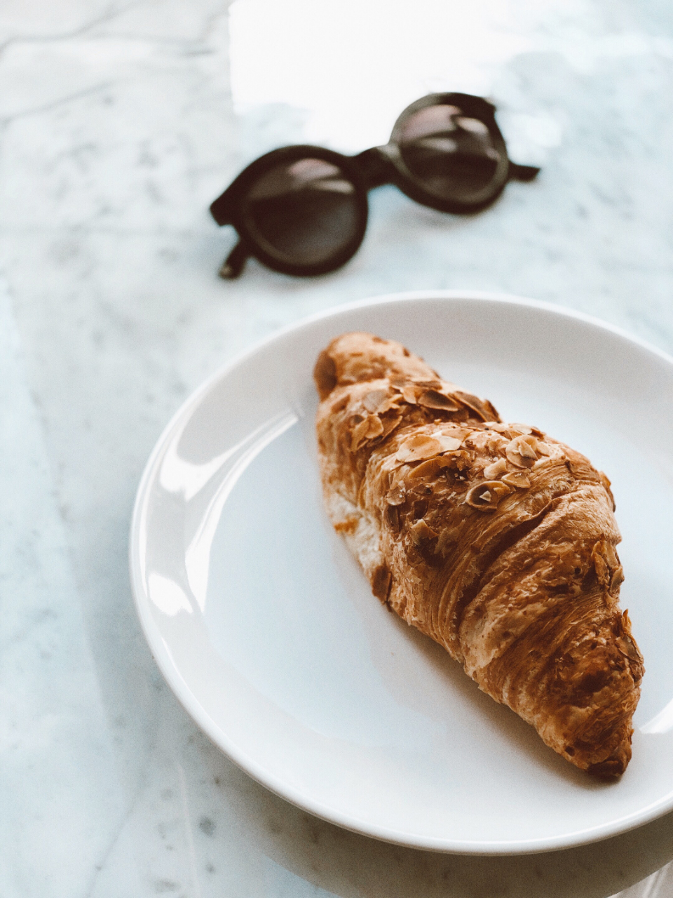 breakfast croissant sunglasses pastry food snack plate white