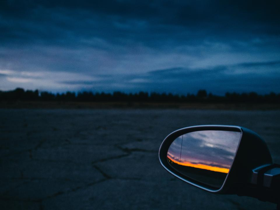 sunset dusk night evening sky clouds mirror car pavement