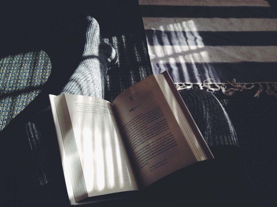 books pages read person people legs feet socks patterns shadows light