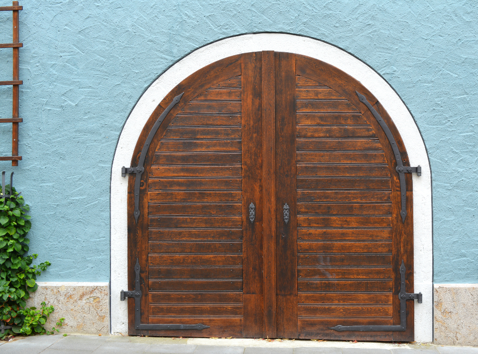 old door building exterior entrance wall stucco design wooden architecture facade frontage street aged blue front city