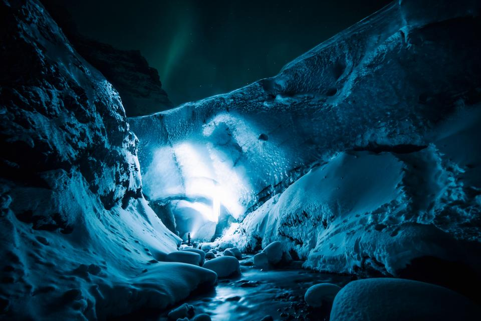 ice cave rocks snow winter lights people travel outdoor adventure