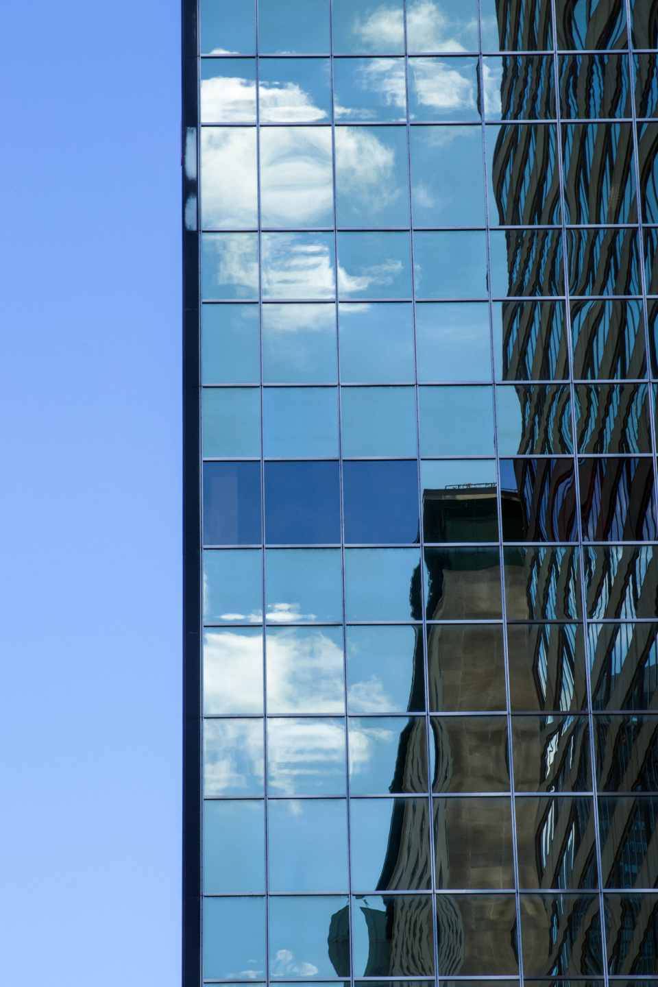 skyscaper city building tall downtown architecture modern urban glass exterior reflection structure business office sky clouds