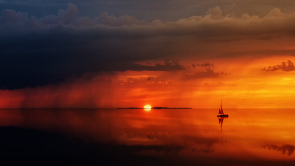 ship ocean sunset rain clouds reflection sea orange magic