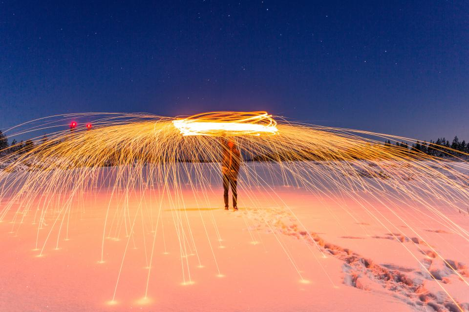 people man fire dance long exposure spark snow footprints winter cold trees night sky stars nature