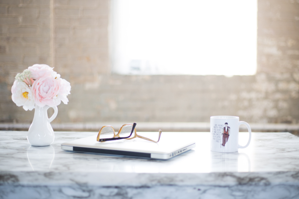 desk flowers office laptop cup glasses table marble interior coffee window freelance writer vase decor