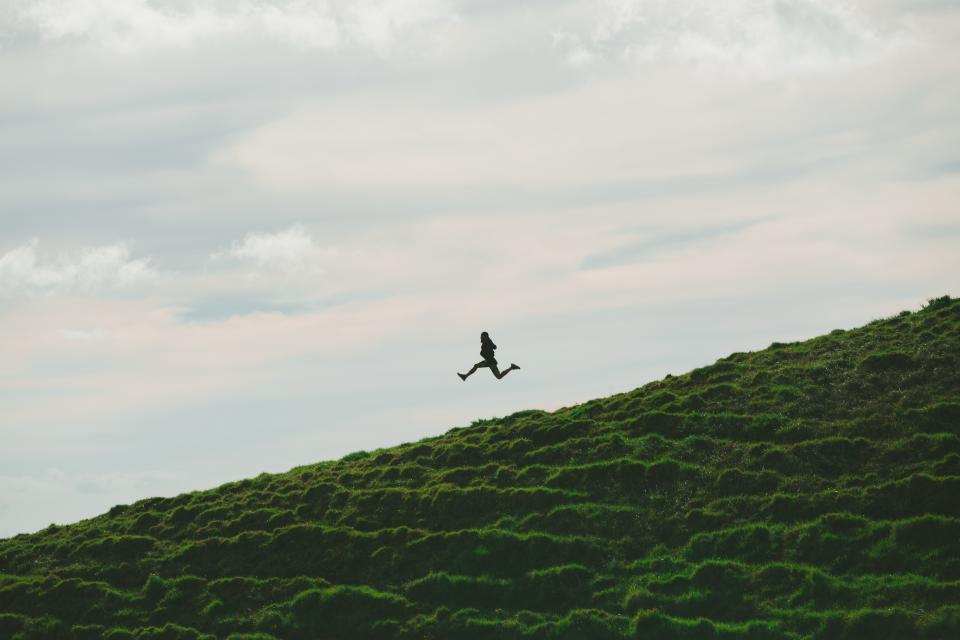 sky clouds nature green grass highland people woman jump