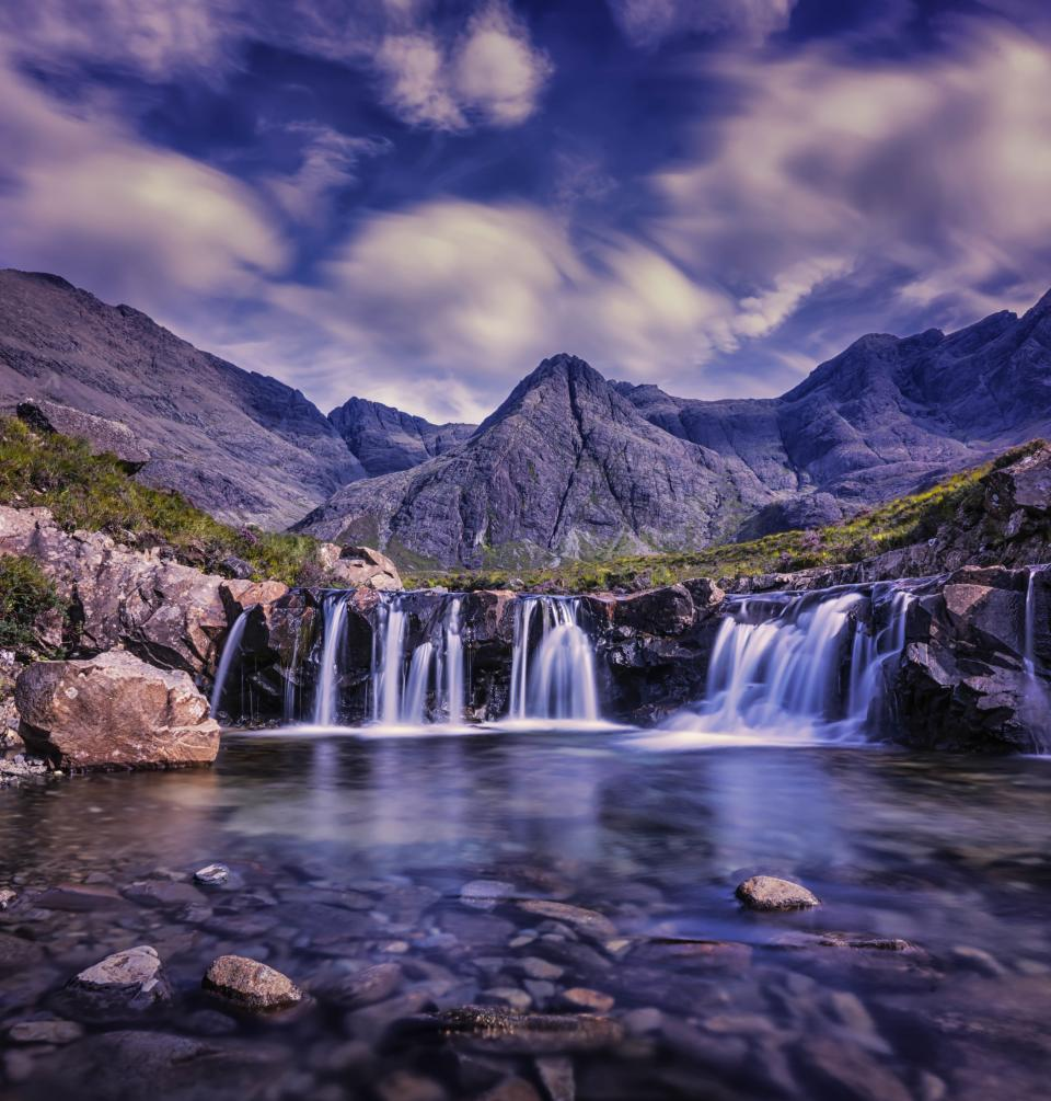 mountain highland stream water green grass nature landscape sky clouds rocks