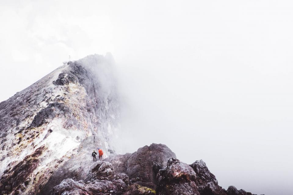mountain hill hiking climbing people men mountaineers rocks adventure outdoor clouds view