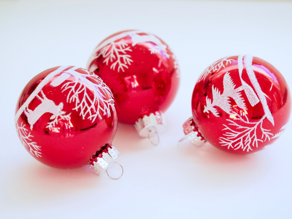 christmas holiday season decorations ornate bauble ball red close up silver shiny glistening reflections merry celebration