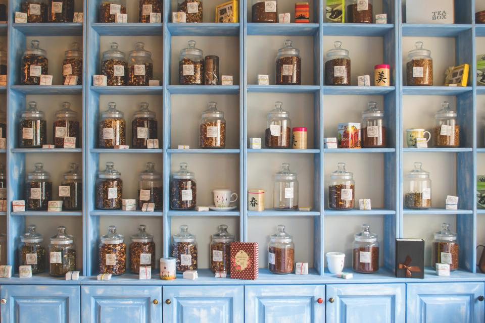 tea jars shelves cupboard kitchen store shopping food drink