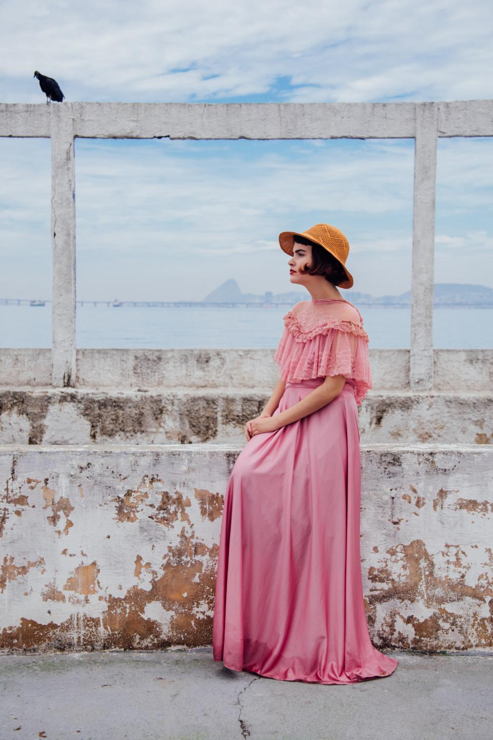 people woman fashion pink hat dress clothing wall blue sky cloud nature bid animal