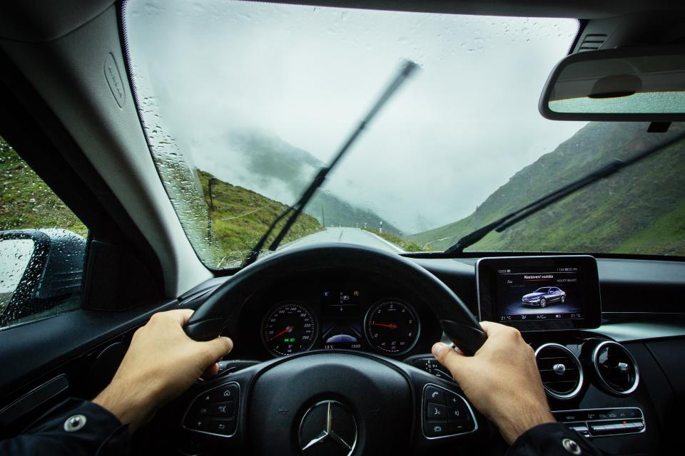 vehicle car inside people hands driver driving travel transportation mercedes benz outdoor adventure mountain rain wet fog sky clouds