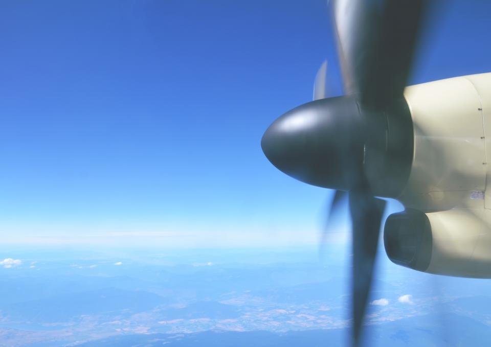 airplane propeller transportation travel trip blue sky aerial view
