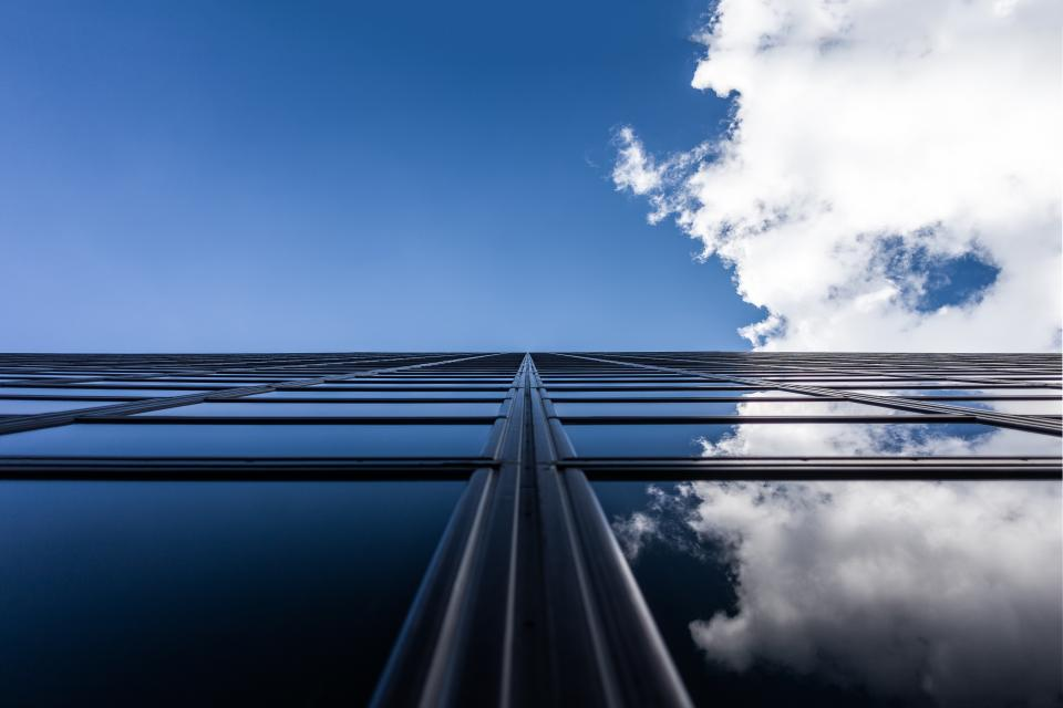 blue sky clouds building windows reflection architecture city urban business corporate