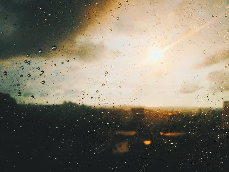 window glass wet water raindrops sunlight sunrise sunset