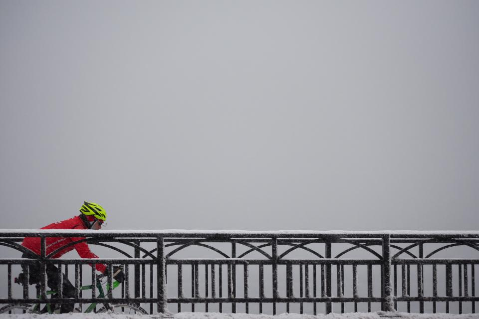 bridge architecture sky people man bike bicycle travel outdoor adventure snow winter helmet horizon