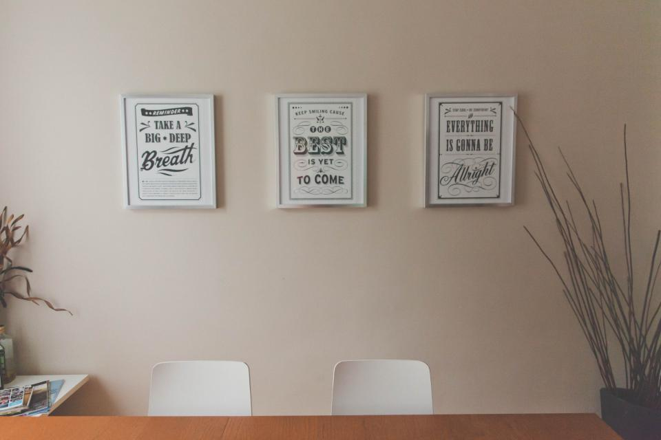 office desk table quotes prints picture frames wall decor room