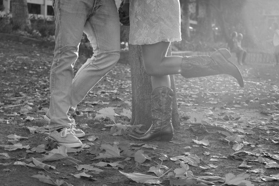 couple love romance romantic autumn cowboy boots leaves black and white