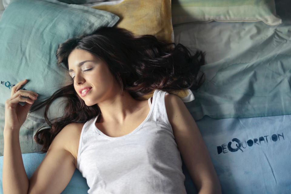 pretty woman sleeping bed smile female girl people asleep tired
