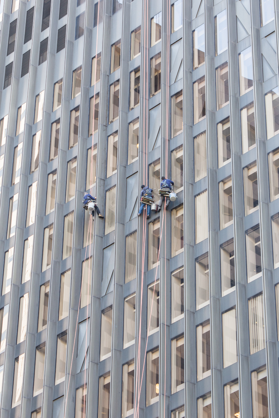 window washers work height city building facade occupation working professional office job safety people clean climbing