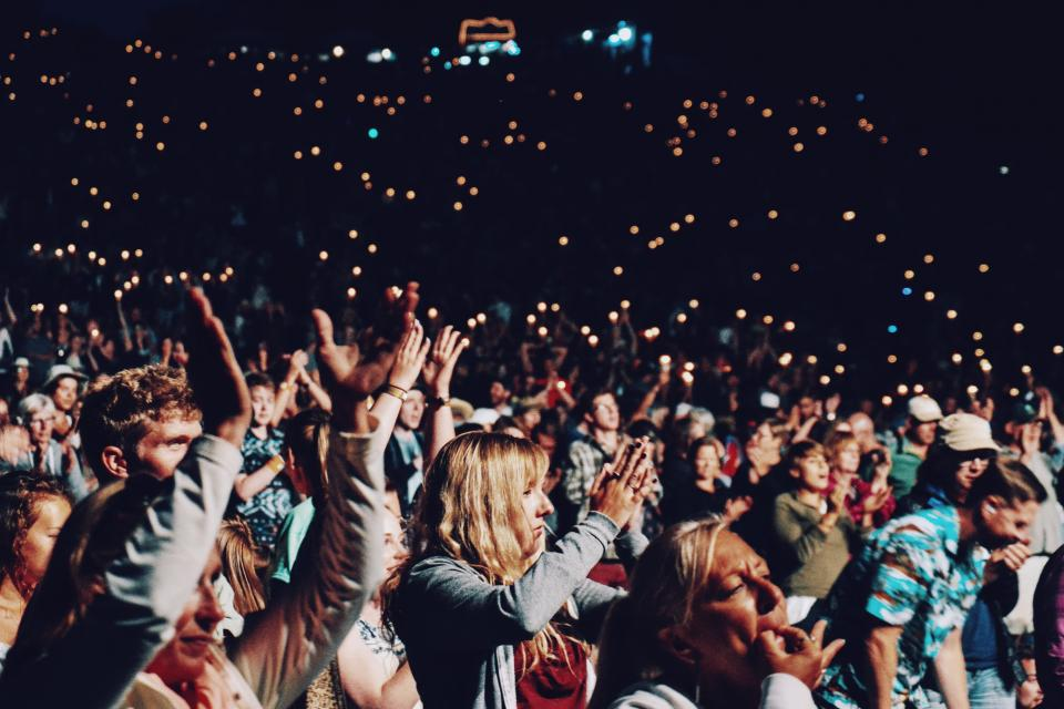people crowd hands clapping party concert celebration lights happy fun stadium group