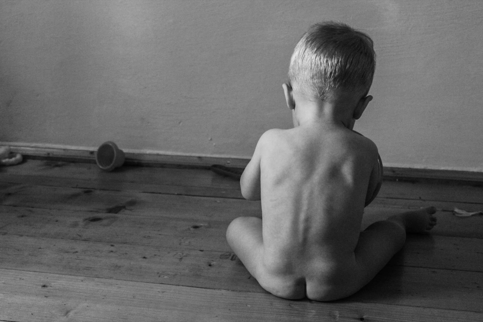 baby child kid back wall floor childhood alone playing waits black and white life background