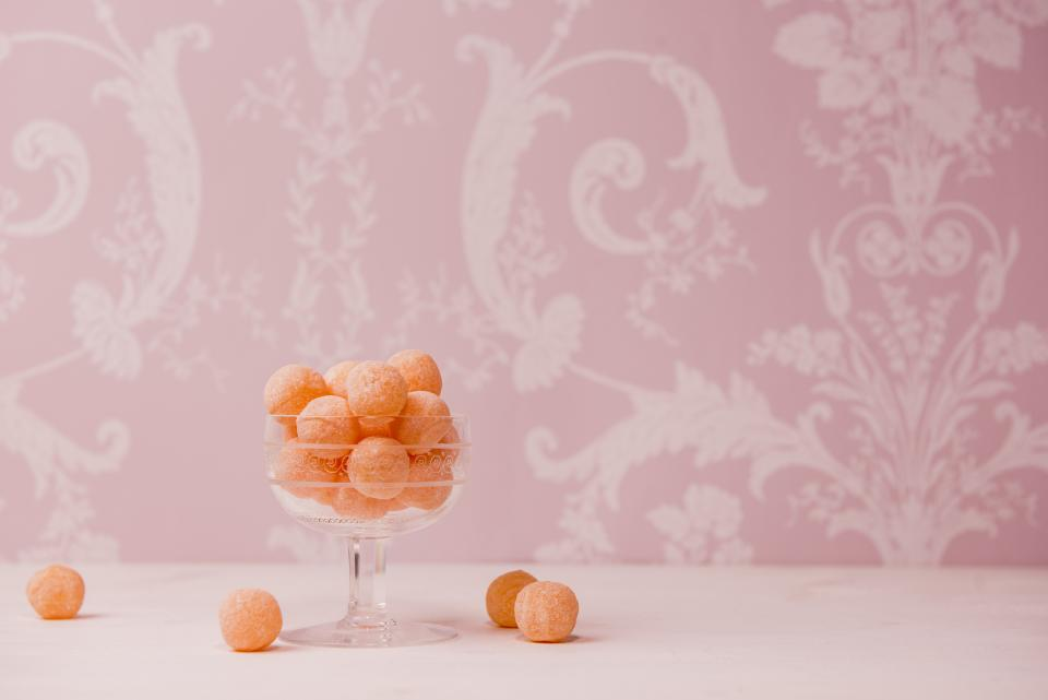 pink wall paper food glass table