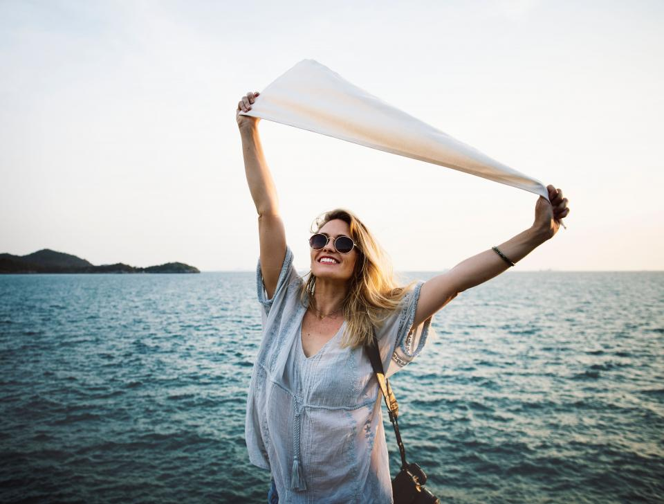 people woman girl sea ocean water travel smile happy sunglasses horizon