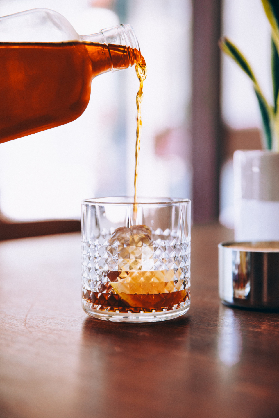 bourbon pouring glass on the rocks ice drink thirsty alcohol close up whiskey bar liquid beverage booze spirits