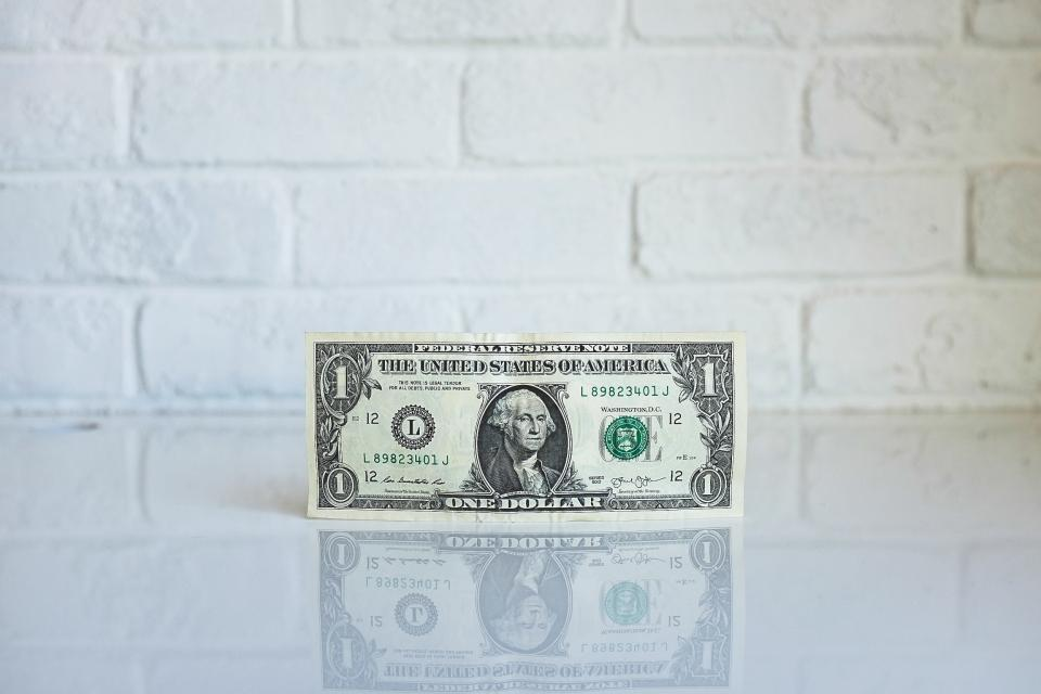 dollar money bill reflection white wall currency finance