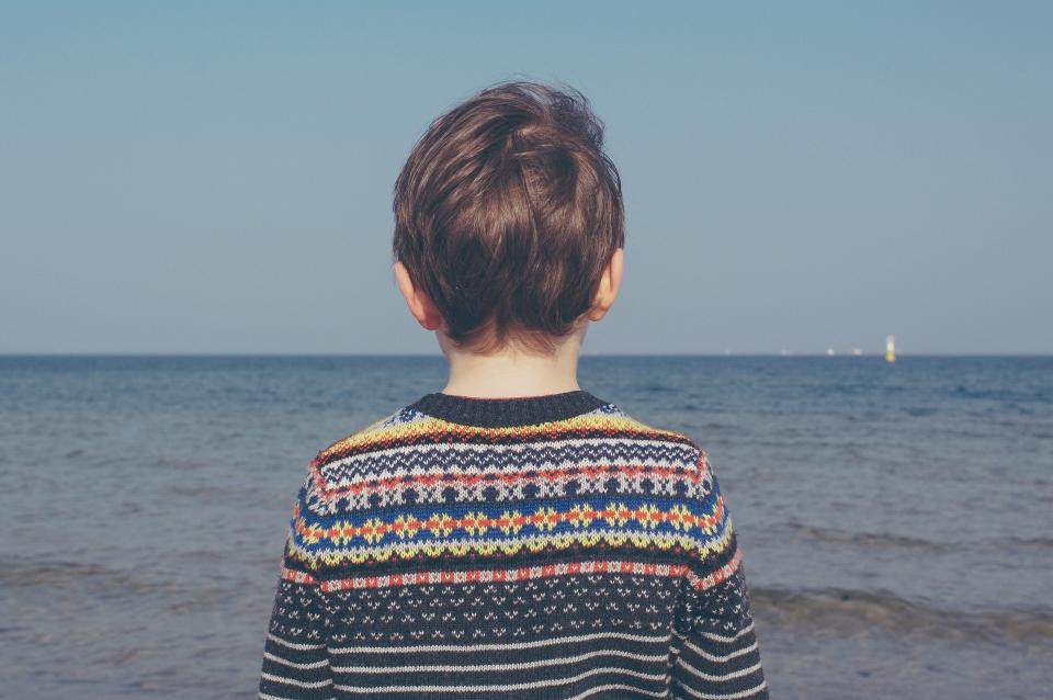 sea ocean water people kid child boy horizon blue sky