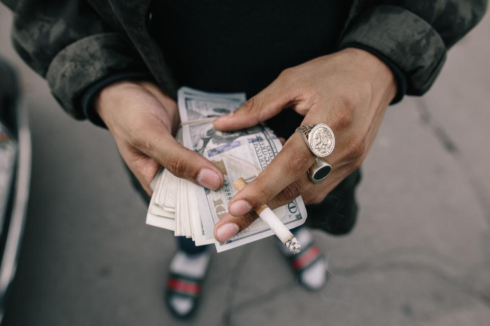 people man hands money bill cigarette smoking ring rich