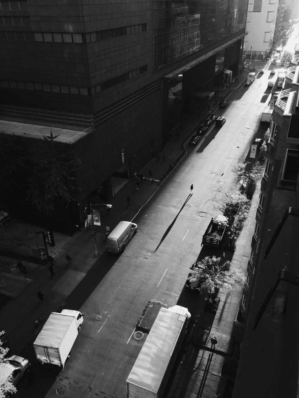 car vehicle transportation urban city monochrome black and white people building shadow trees establishment