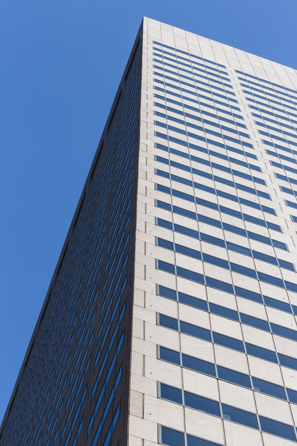 city sky downtown urban architecture daytime business perspective exterior modern structure tall building skycraper windows