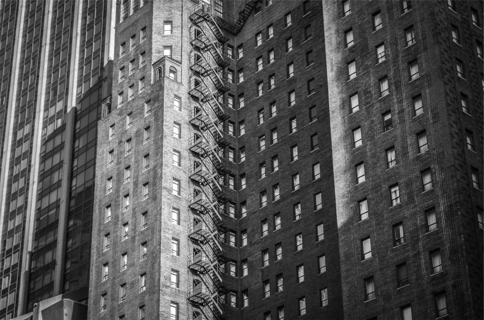 building apartment city urban architecture windows fire escape windows black and white