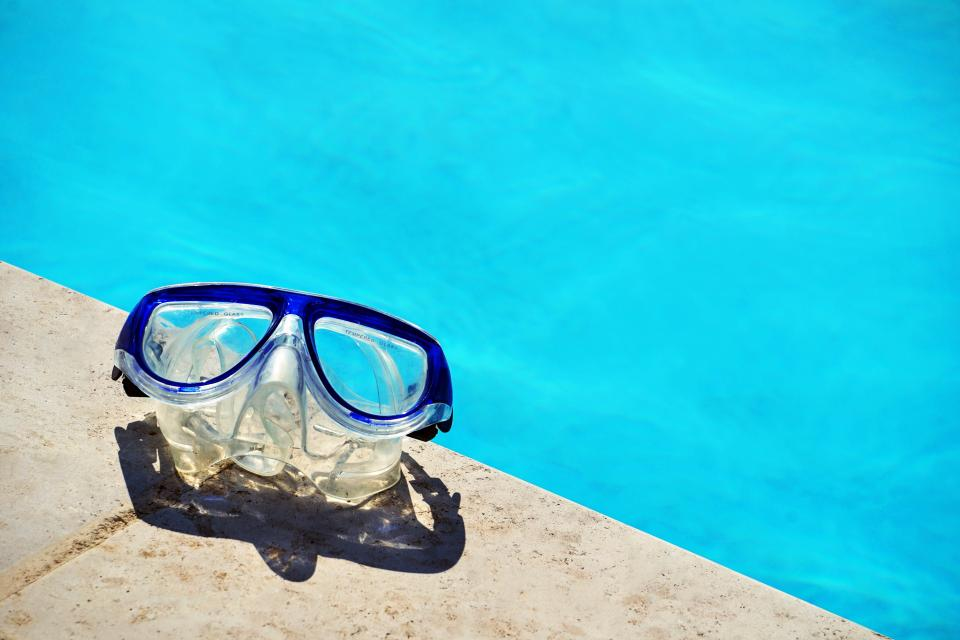 swimming pool blue water swim goggles